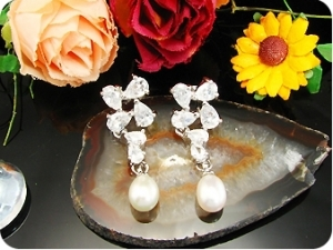 Exotic 2x9mm White Fresh Water Pearl Oval Cut Earrings
