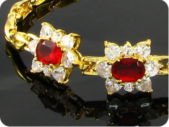 3x9mm Red Rubies White Topaz Gold Bracelet