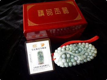 CLUSTER OF GRAPES IN JADE , SYMBOL OF MAJOR ACHIEVEMENTS