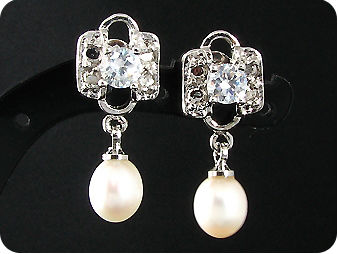 2x8mm White Fresh Water Pearl Oval Cut Earrings