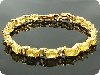 12 x 7mm Yellow Topazes Oval Cut Gold Bracelet