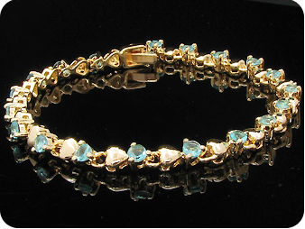 19 x 3mm Blue Sapphires Gold  Bracelet