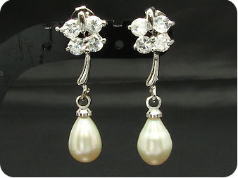 Voguish 2x7mm White Fresh Water Pearl Oval Cut Earrings