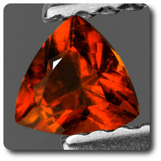 0.29 cts CLINOHUMITE ORANGE. IF + CERTIFICAT