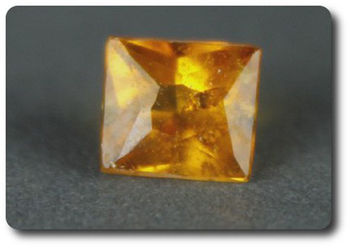 0.17 cts CLINOHUMITE ORANGE. VS