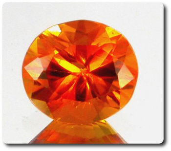 2.75 cts CLINOHUMITE ORANGE. VVS