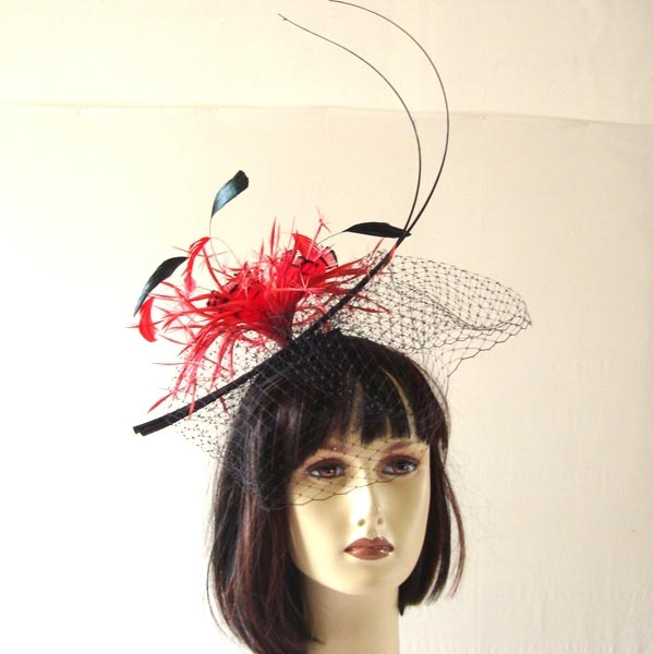 Wedding fascinator with feathers and veil