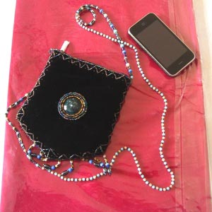 Velvet, pearls and ceramic make it a very special bag
