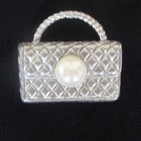 Quilted clutch brooch