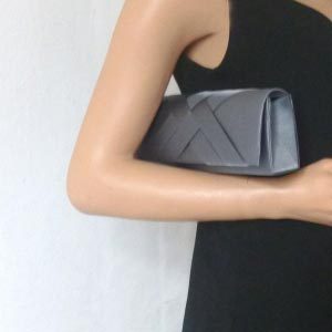 "Our pewter ""baguette"" shaped satin clutch"