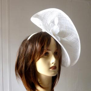 Unusual fascinator with two disks on a headband