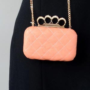 Little evening clutch, box-shaped with gold and diamonds rings