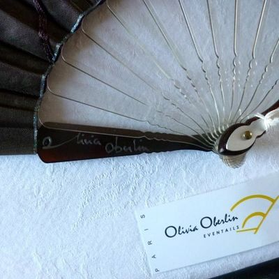 Brown organza fan with arabesques by Olivia Oberlin