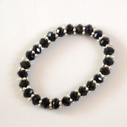 Fine black bracelet with facetted crystal pearls