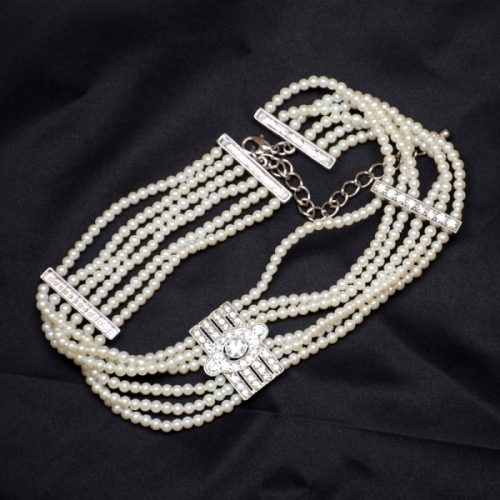Necklace sautoir pearls and metal art deco