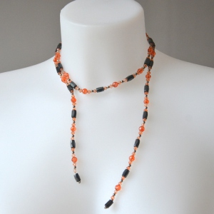 Necklace - sautoir - bracelet with orange and black magnetic stones