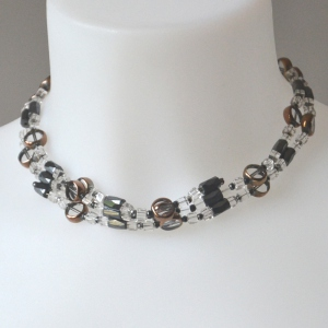 Magnetic necklace with transparent, black and copper pearls,
