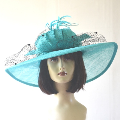 Wide-brimmed turquoise wedding hat with black veil