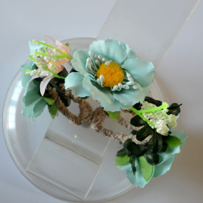 Fabric bracelet with light turquoise flowers