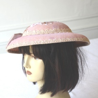 Soft pink wedding hat with butterfly shaped knot, jewel and appliqués flowers