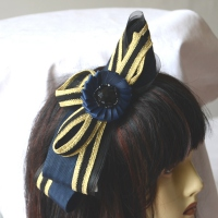 Wedding or evening fascinator with a golden stripe