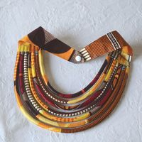 African wax necklace - 7 rows - orange, yellow, black and white