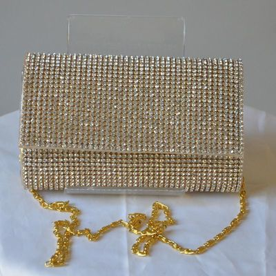 Lovely evening clutch, silver or golden with rhinestones