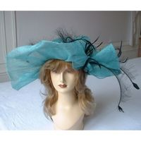 """The"" wide-brimmed wedding hat with turquoise sinamay and black feathers"