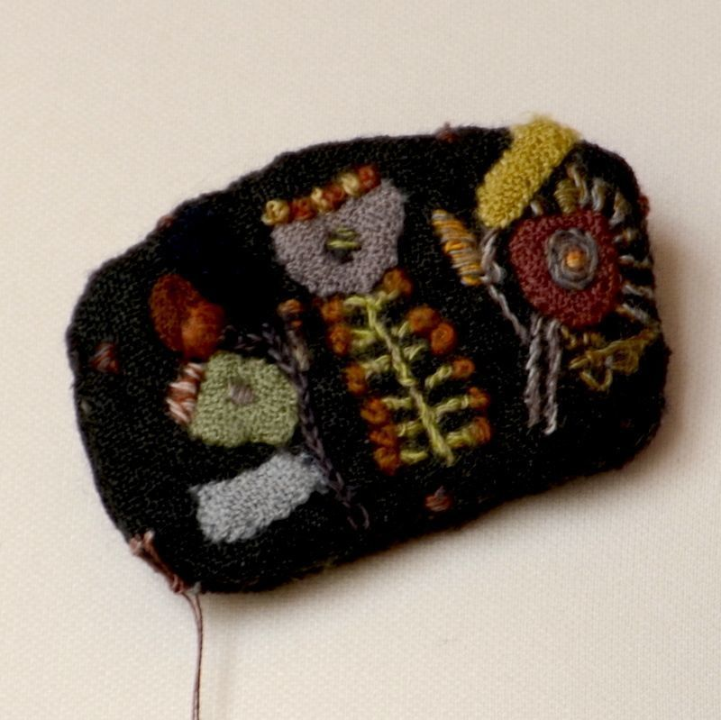 Sophie Digard brooch - dark brown background, coloured hand embroideries