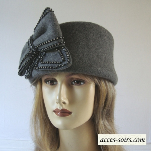 High ivory pill box hat with a bowfly with rhinestones