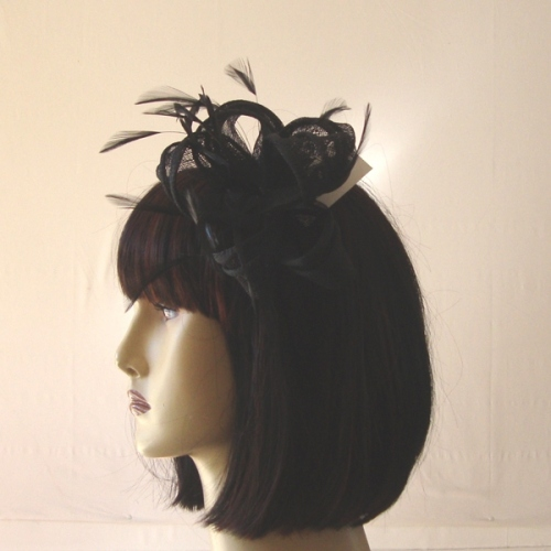 Wedding fascinator with feathers and sinamay loops