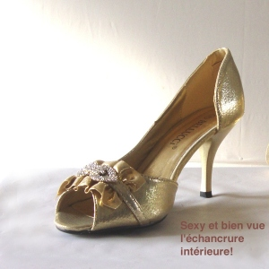 Golden evening shoes with rhinestones