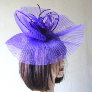 Large purple wedding fascinator for impressive events on hairband