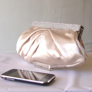 Champagne beige satin evening clutch with rhinestones