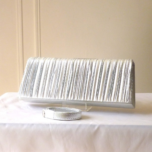 Long silver satin pleited clutch