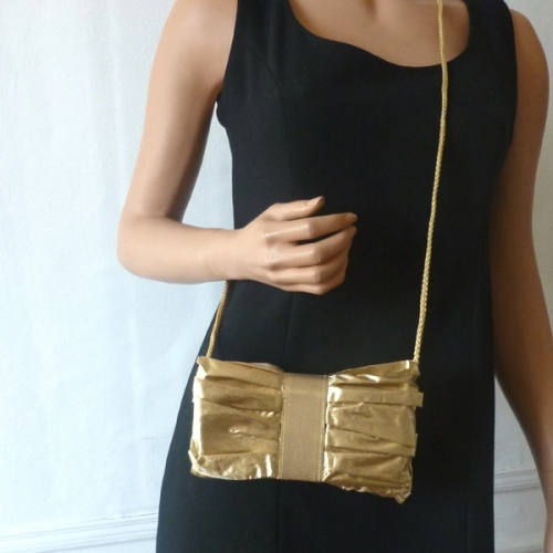 Pleated golden evening bag