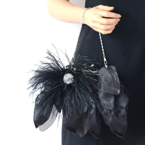 Black evening clutch with rhinestone and feathers