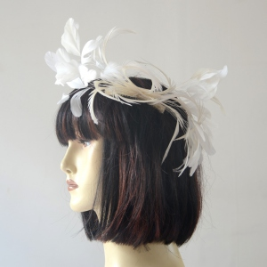 Red fascinator with feathers for weddings or evenings