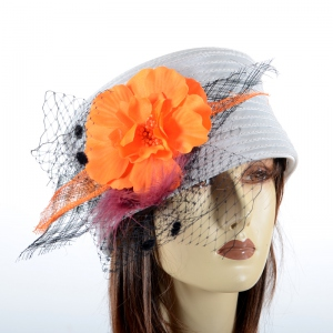 Pillbox hat with poppy and veil