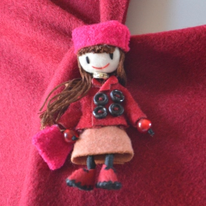 Lovely little doll brooch fuchsia wool