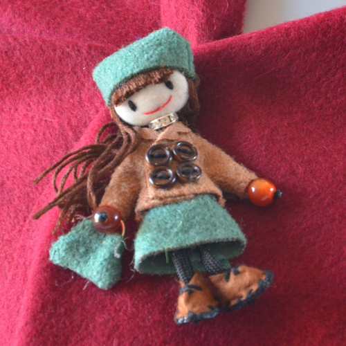Little hand made green doll brooch