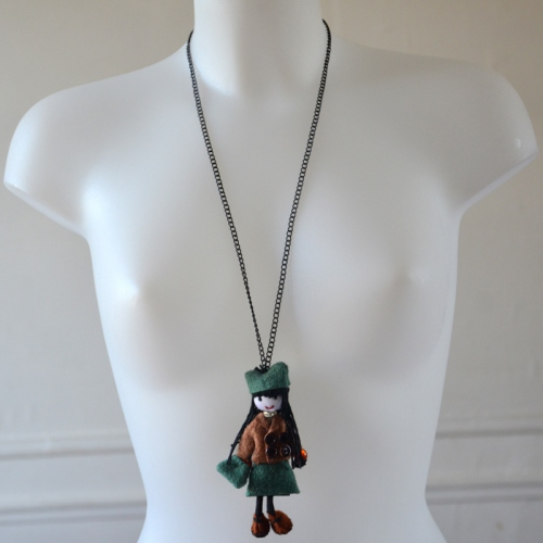 Long necklace with a green woolen doll