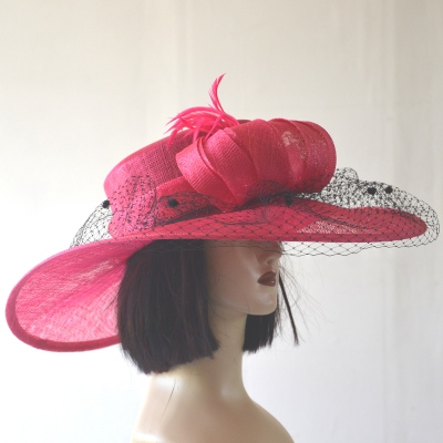 Wide-brimmed sinamay fushia wedding hat
