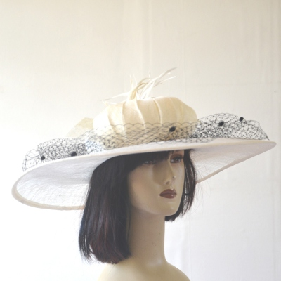 Wide-brimmed white/ivory and black veil wedding hat