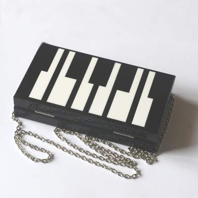 Evening clutch plexiglas black and white piano