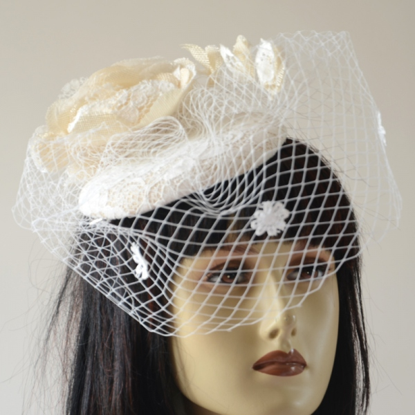 Ivory bibi with veil for the bride