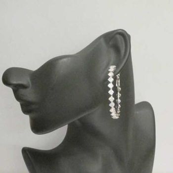 diamond crystal mounted on a creole earring