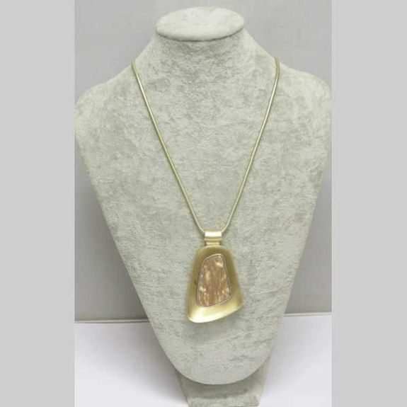 gold metal necklace with resin pendant