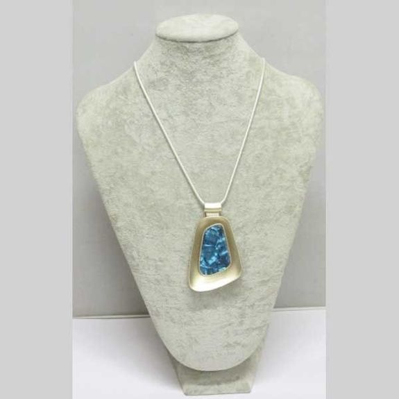 blue resin pendant mounted on metal chain