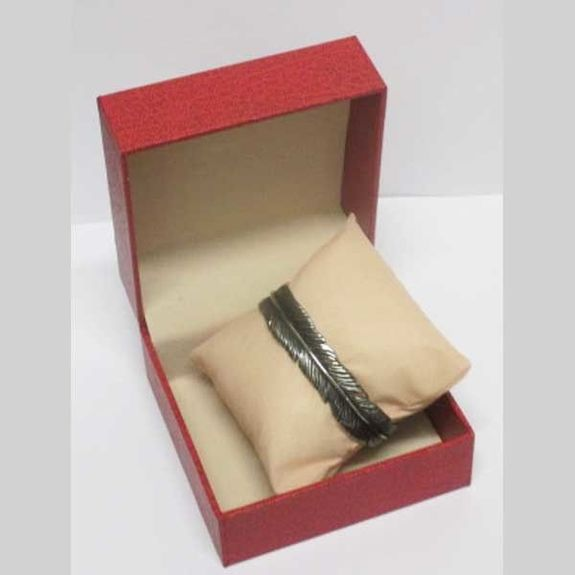 feather steel cuff sold in its case